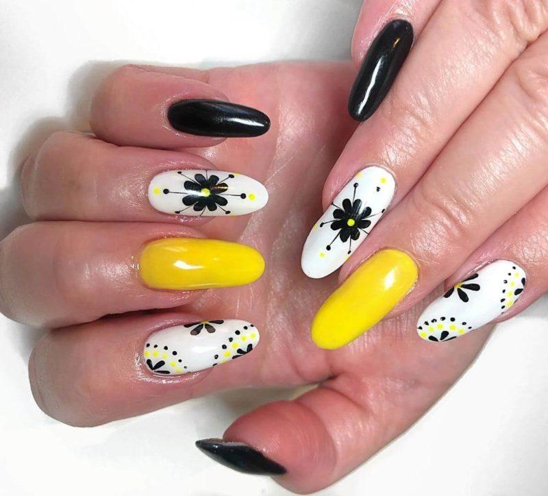 Желтый маникюр с черным