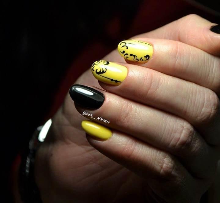 Желто-черный дизайн ногтей